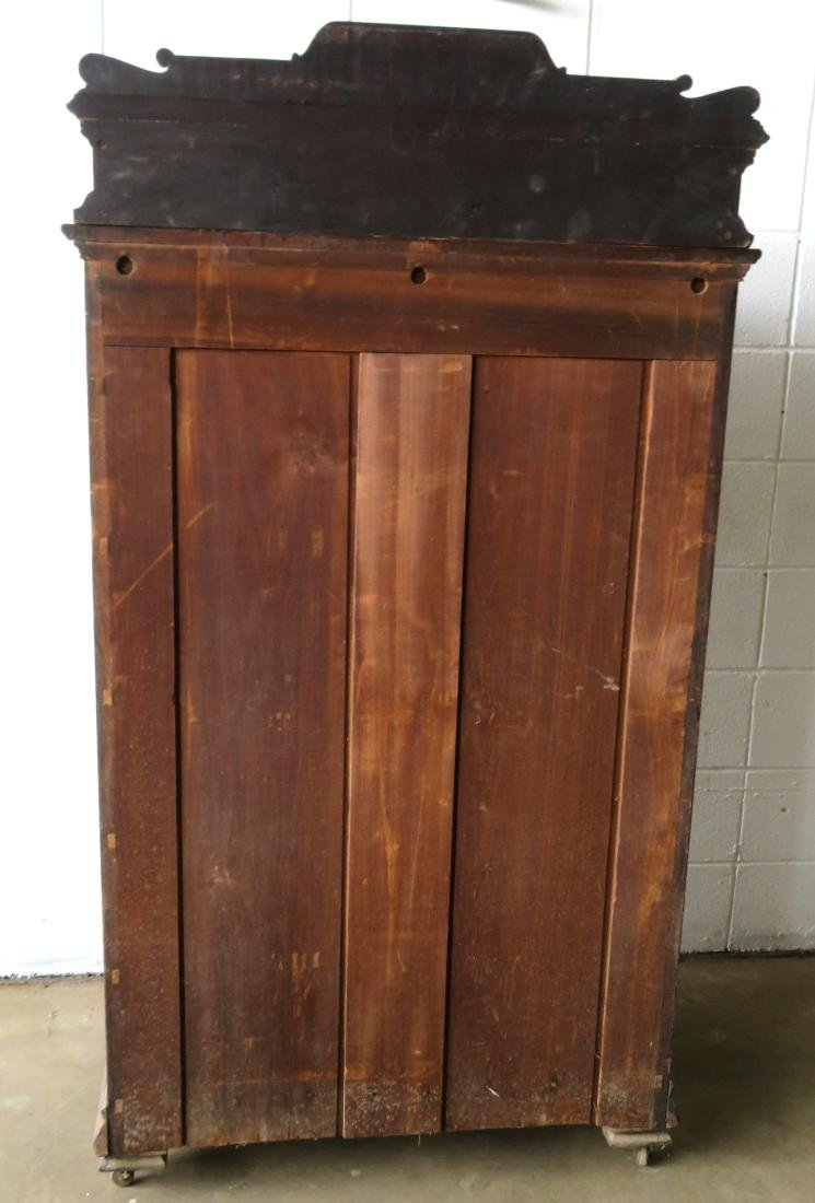 Black walnut side lock chest having a carved wooden - 6