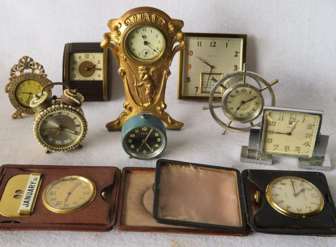 Grouping of 10 dresser and traveling clocks including 8