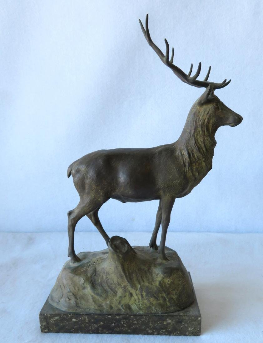Bronze sculpture of a standing elk, mounted on a marble