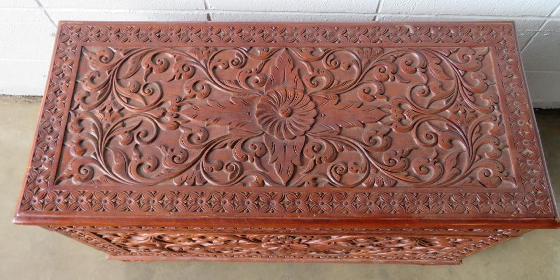 Profusely carved wooden hope chest decorated with - 2
