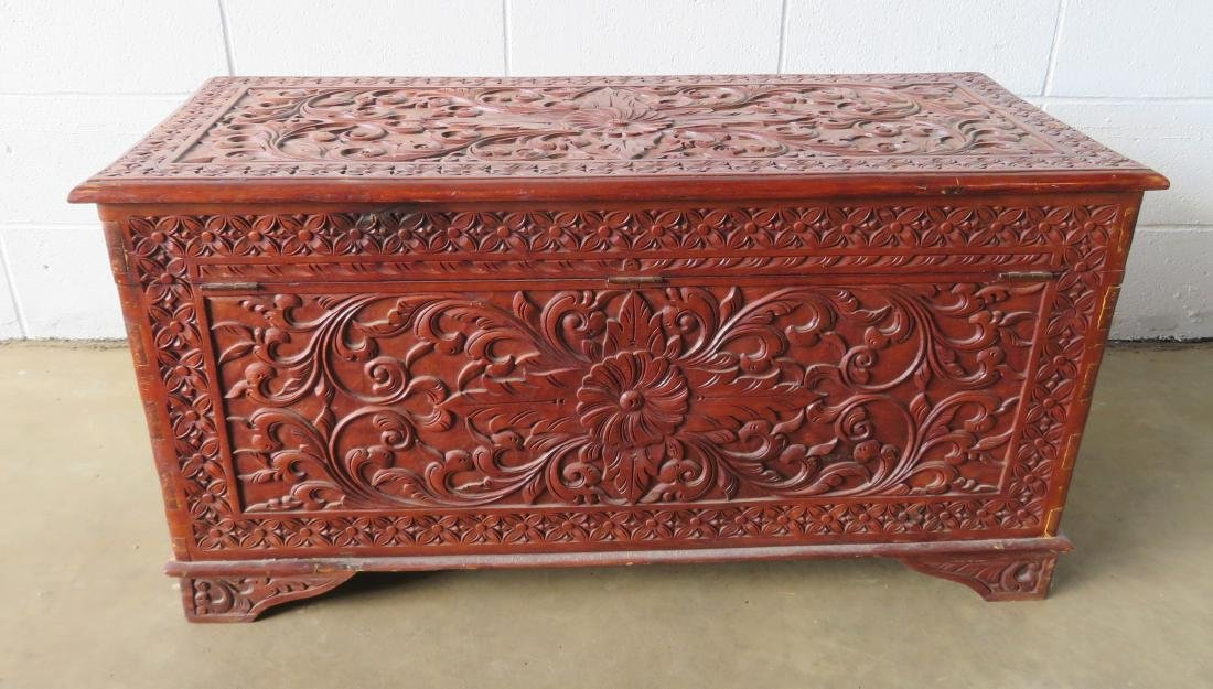 Profusely carved wooden hope chest decorated with - 4