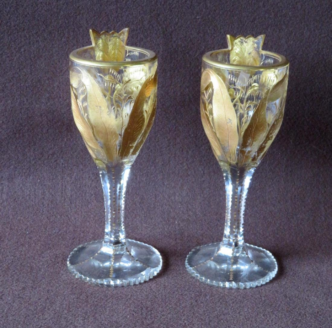 Two ornate cut crystal wine glass in original gold
