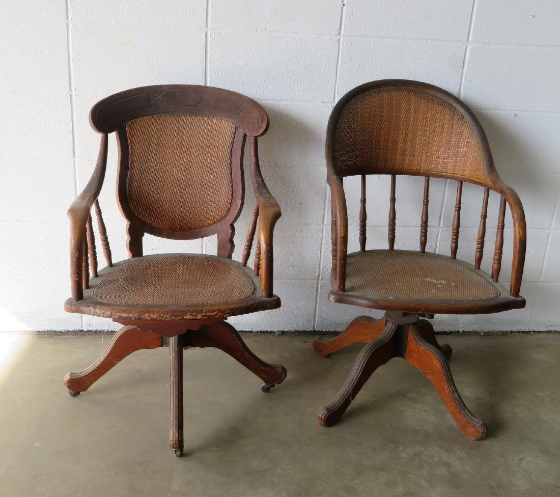 Two walnut Victorian office chairs with cane seats and