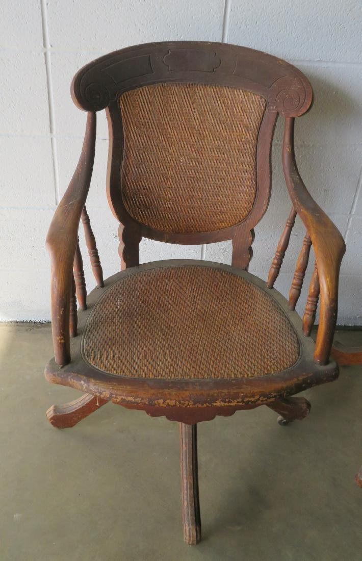 Two walnut Victorian office chairs with cane seats and - 2