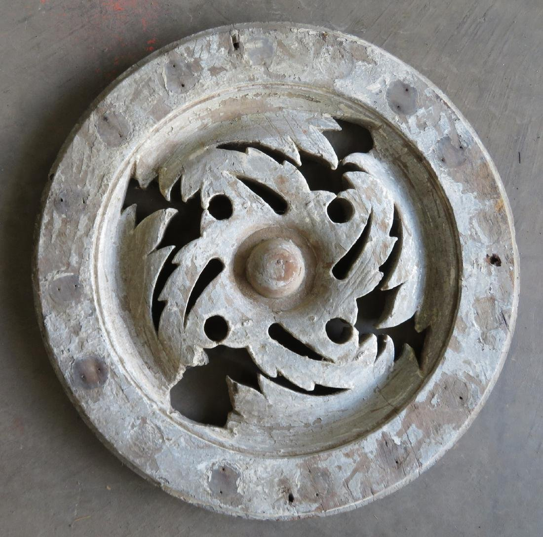 An architectural wooden circular ceiling or wall orname