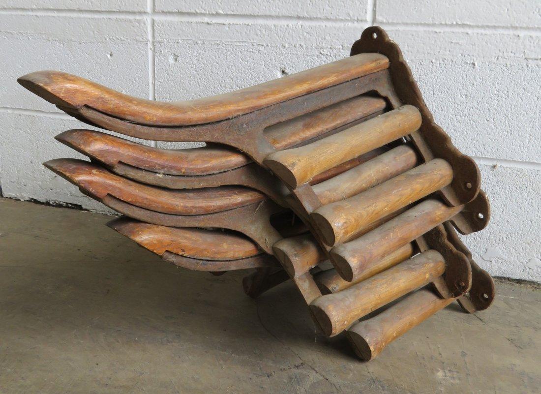 Four vintage wood & iron saddle holders.