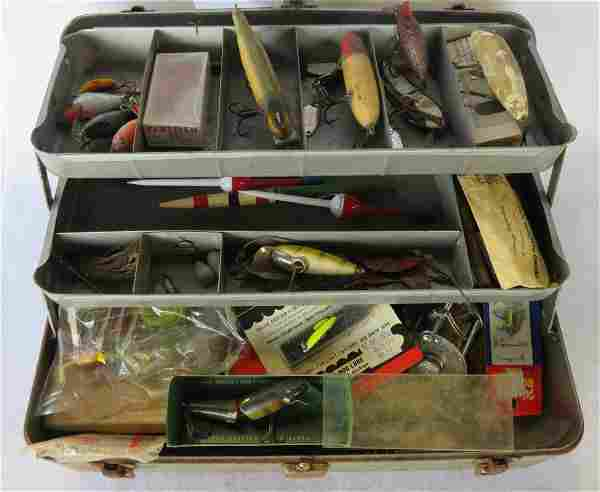 A fishing box filled with various fishing lures, hooks
