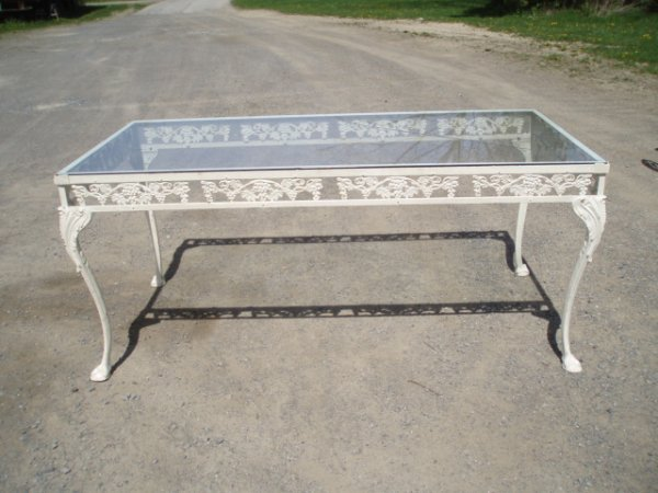 """1: Metal table (66"""" x 32"""") and four chairs"""