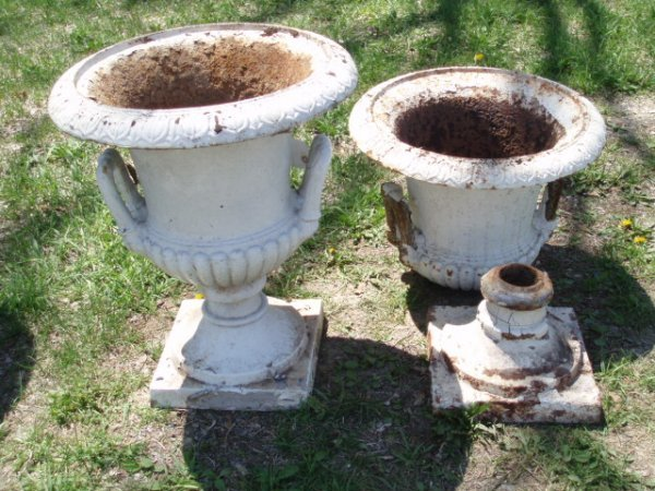 9A: Four cast iron matching garden urns - one is comple
