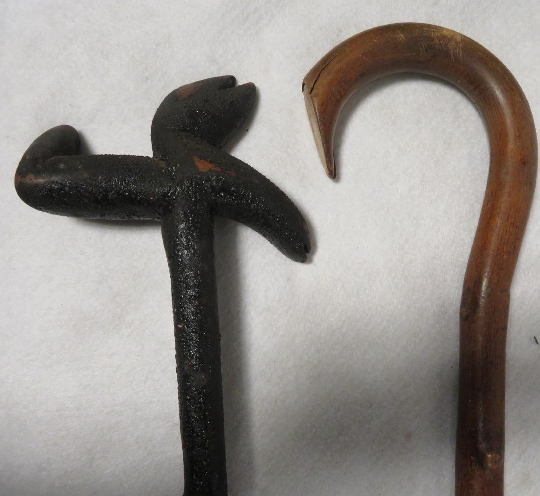 Two vintage wooden walking sticks. One in hickory and t