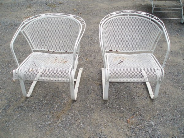 15: Four Pieces of Iron Outdoor Furniture inc. Two Armc