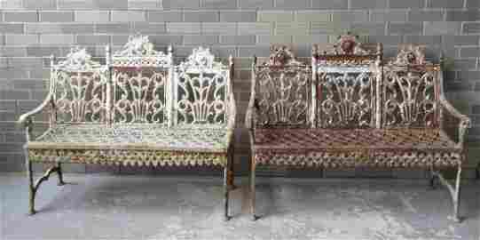 A pair of American classical cast iron garden benches