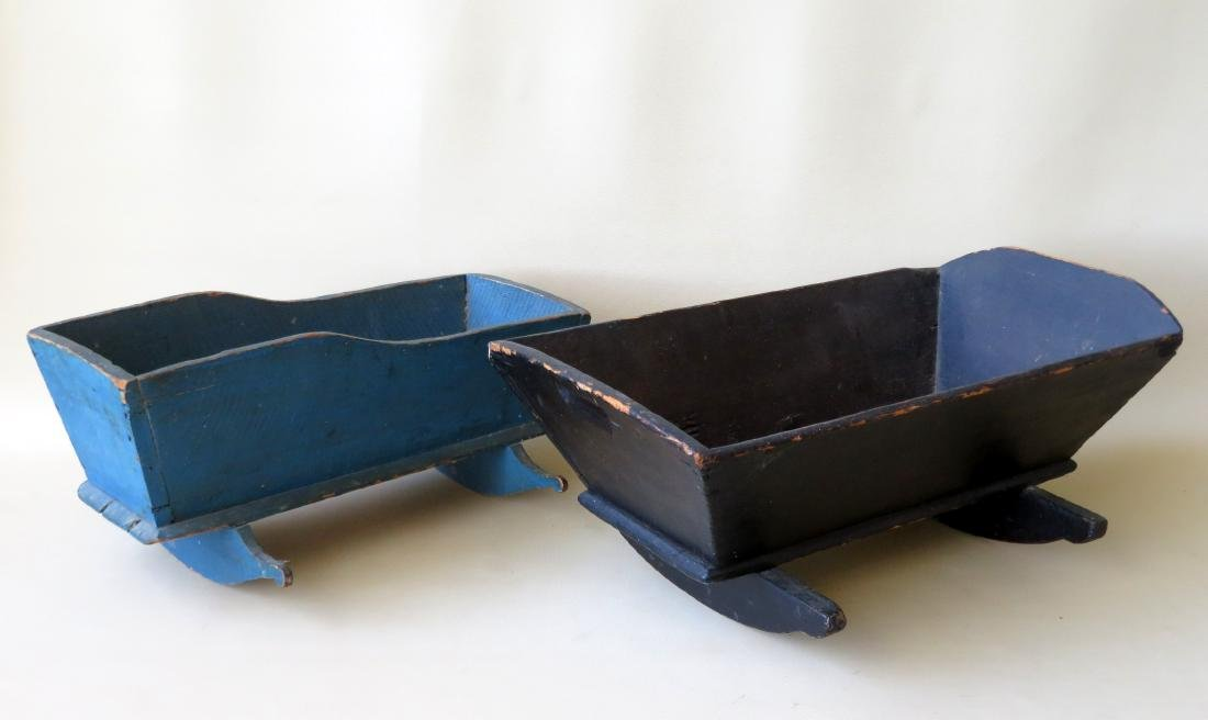 Two doll cradles in old including one in blue which