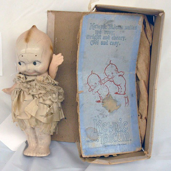 "8: 7"" Kewpie Composition Talcum Powder Container in ori"