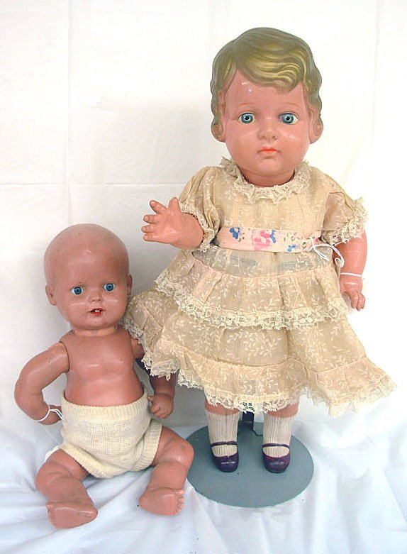 13: Lot of 2 Celluloid Swivel Head Dolls .