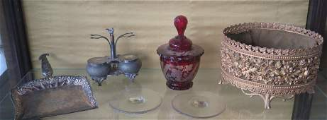 Grouping of decorative objects including: A cranberry