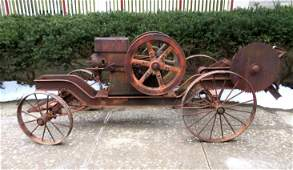 Economy 5 HP buzz saw rig with iron wheels and small