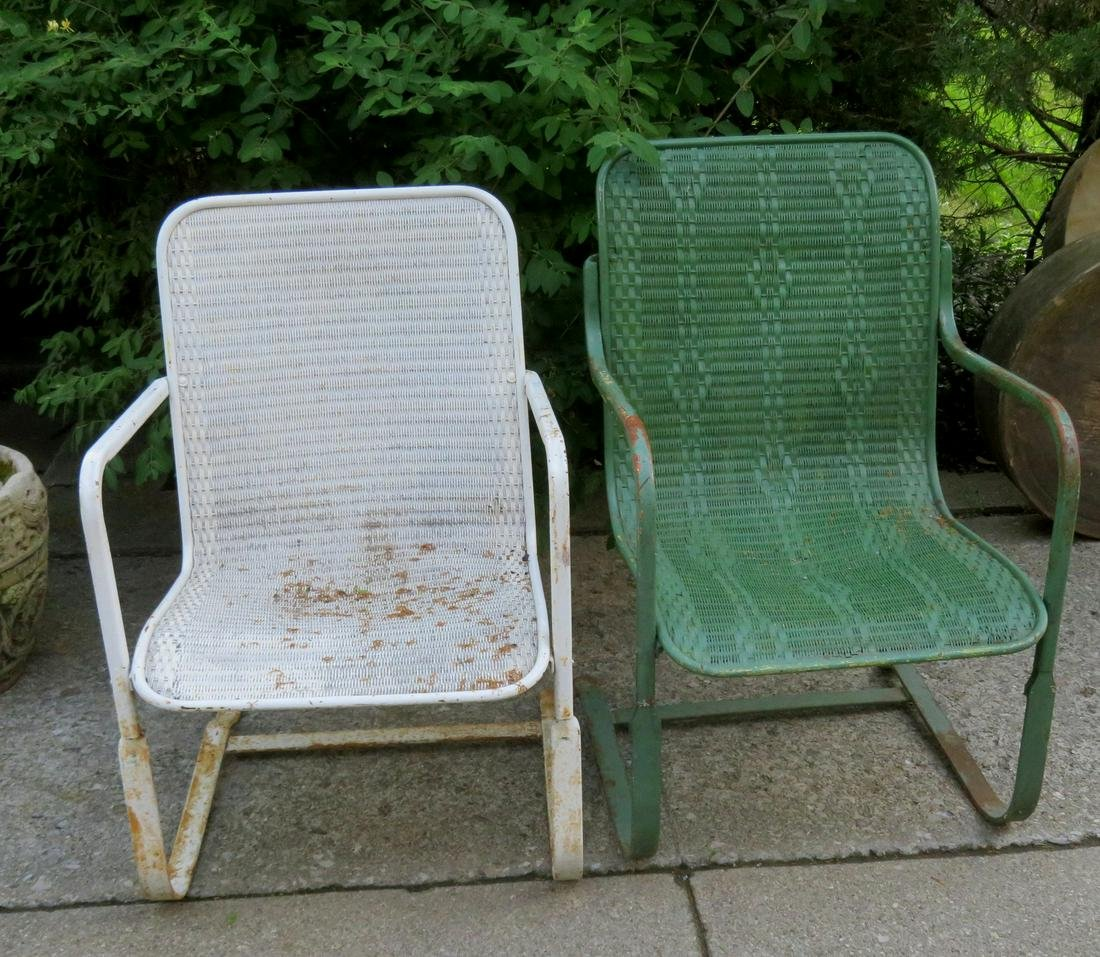 A pair of woven wicker chairs on sheet iron rocking