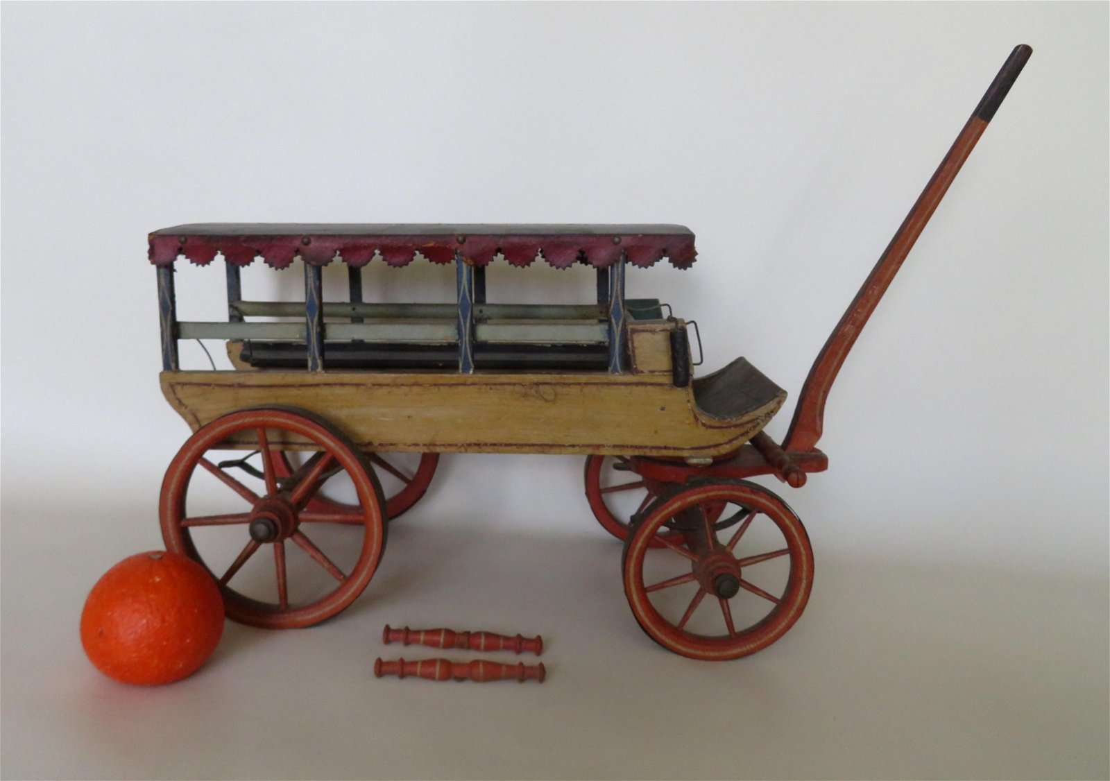 A toy or salesman sample model of a horse drawn covered