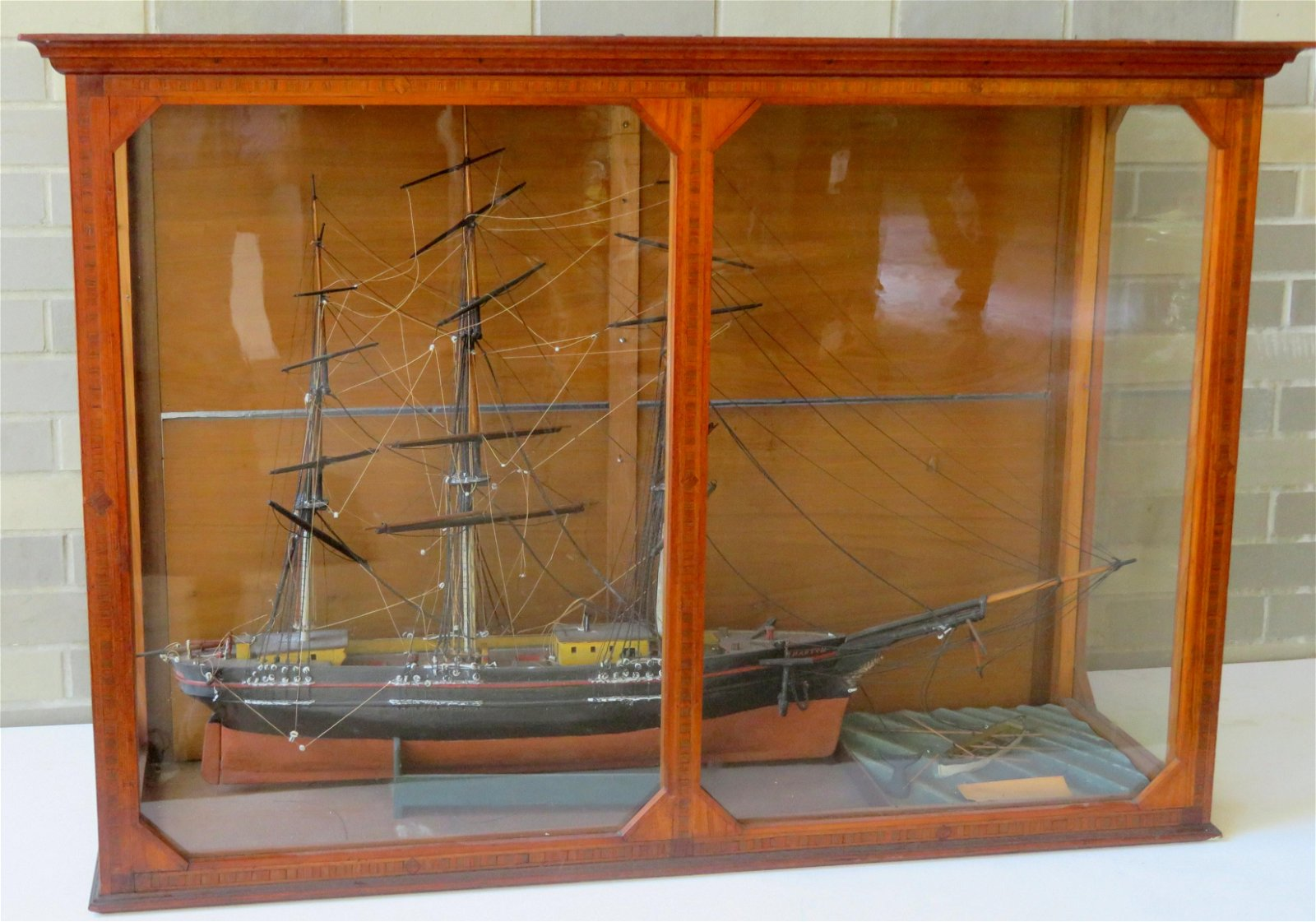 A glass encased 3 mast sailing ghost ship model marked