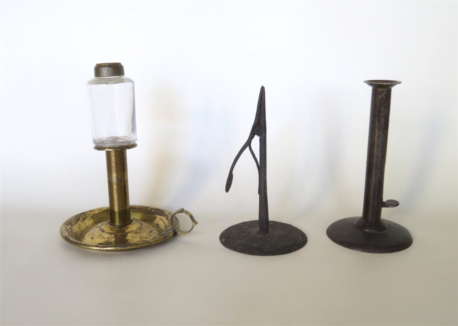 Three early lighting devices including a hand forged