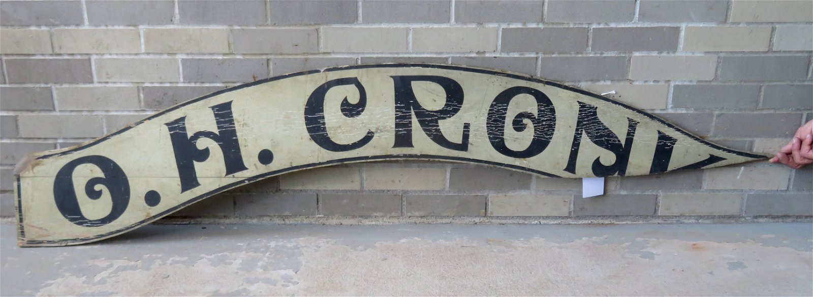 "Vintage curved wooden store sign marked ""O. H. CRONK"" -"