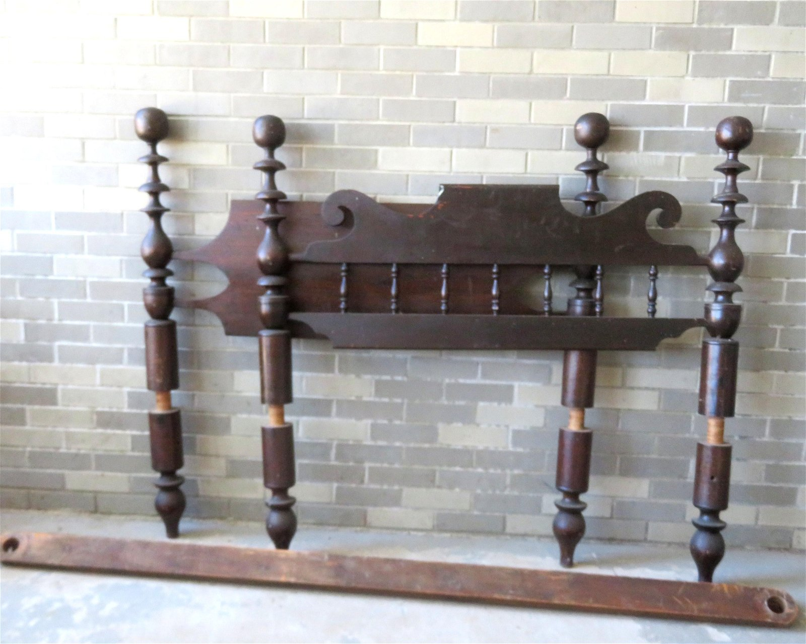 An unusual early maple and pine wooden bed with turned