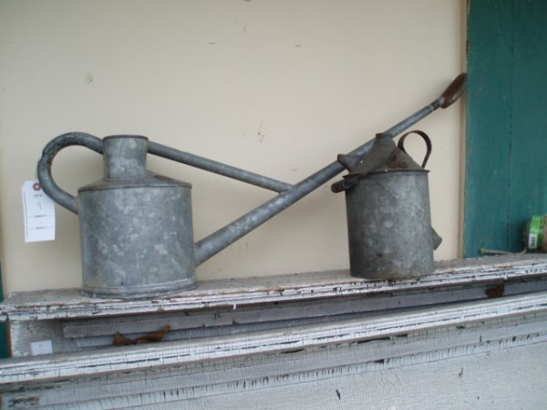 9: Old water sprinkling can plus old tin oil can