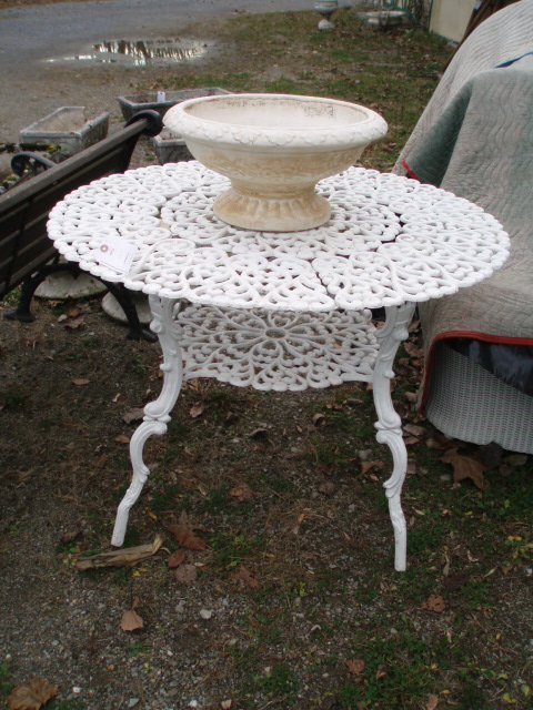 12: Aluminum round table w/reticulated top plus earthen