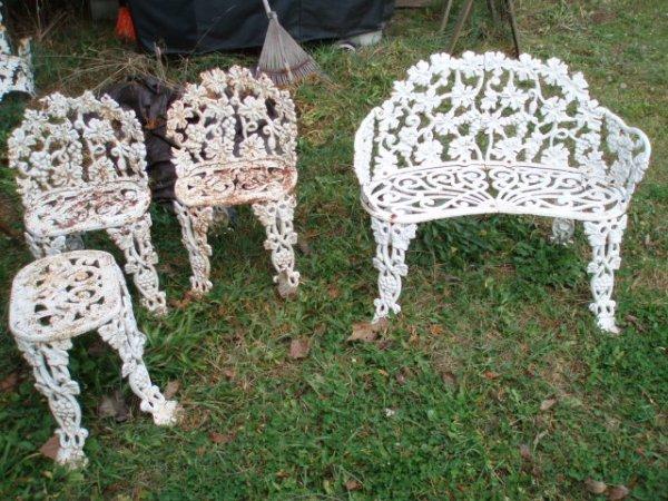 20: Four-piece cast iron garden set in grape pattern