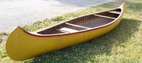 22: Canoe - canvas-covered w/wooden slats - early 1900s