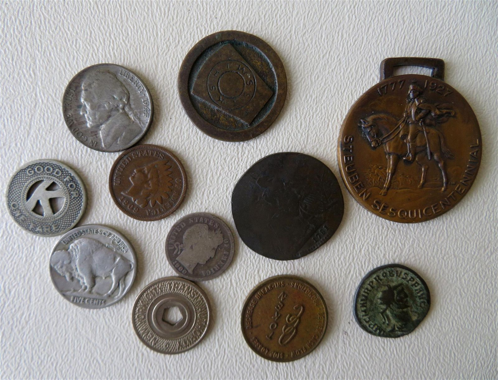 Grouping of coins/tokens, most American, including: A