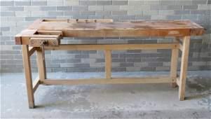 A modern carpenter's wooden work bench having an