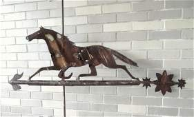 An early hand made silhouette running horse