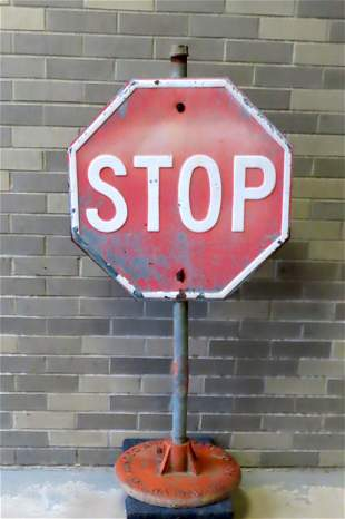 Standup sheet iron STOP sign mounted on cast iron
