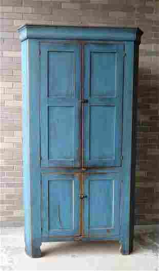 A good 4 door corner cupboard in blue paint (probably a