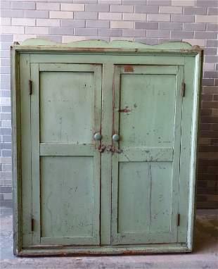 A good 2 door cupboard in old green paint over original