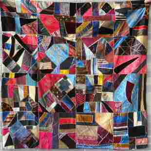 A youth size crazy quilt, 19th century. Patches