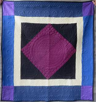 A very fine Amish quilt in the Diamond in Square