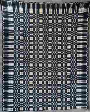 A Blue and white 2 part coverlet in pine tree and
