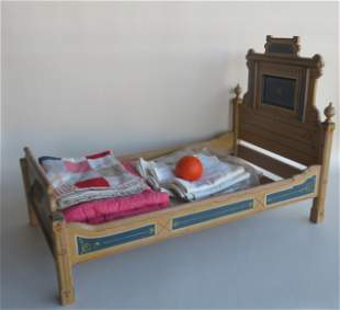 The best Victorian Eastlake doll's bed and doll