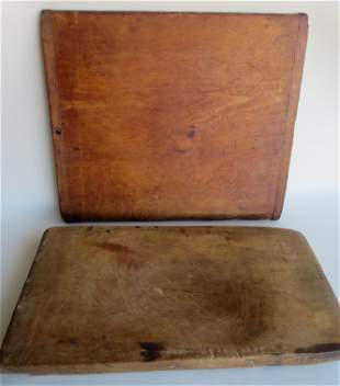 Three primitive wooden cutting boards, one with