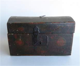 A small dome top document box with wire bail handle on