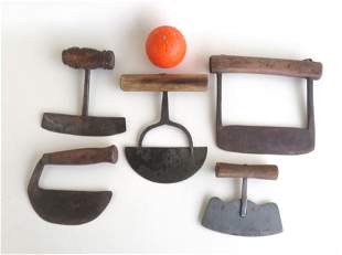 A grouping of 5 early hand forged iron food choppers