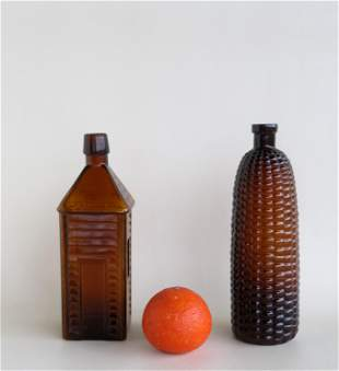 Two figural bitters bottles including: The first an Old