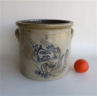 A 3 gallon stoneware crock decorated with a large