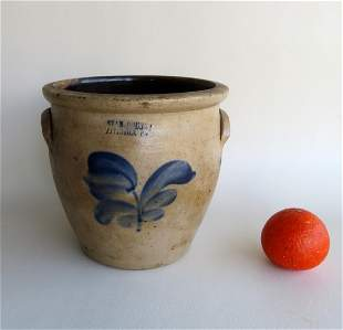 A stoneware crock, slightly ovoid in shape, decorated