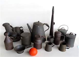 Large grouping of early tinware including teapot,