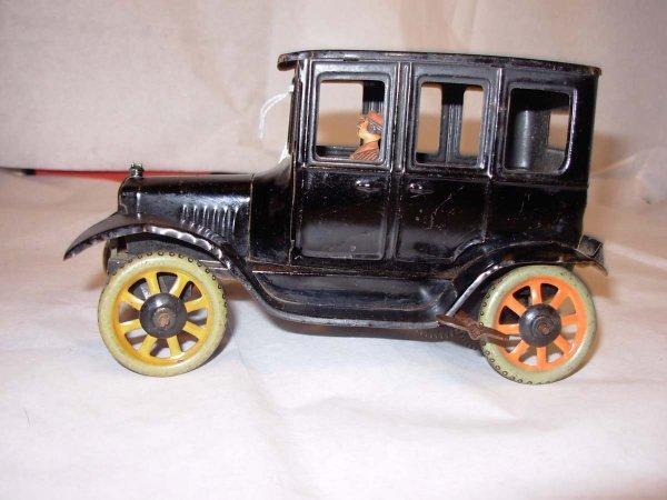 98: Bing Model-T Sedan windup, lady driver, minor repai