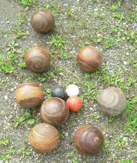 "1007: Set of bocce balls signed ""England"" in rosewood"